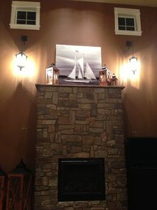 Dramatic Fireplace in 2 Story Great Rm with Gas Fireplace Next to Wall of Views