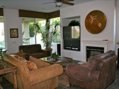 Comfortable great room with gas fireplace, big screen HD TV and views