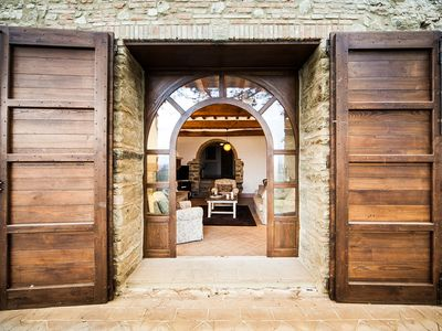 Double arched doors to outdoor view loggia with custom wooden secondary doors