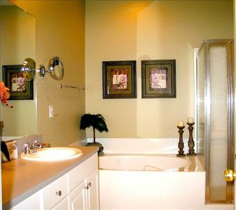 Master Bath with jet tub/walk-in shower/mounted make-up mirror and hair dryer!