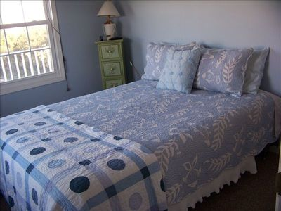 Sky Blue Room With Queen Bed and TV