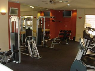 Ahwatukee condo photo - Exercise equipment including free weights and 2 flatscreen TV'S