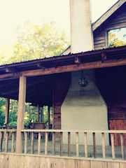 Apalachicola cabin photo - fireplace and wrap around porch.