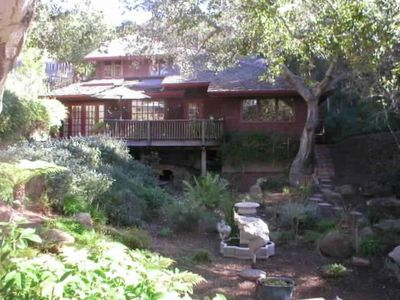 Two story house, over an acre of landscaped grounds, fountain, seasonal creek