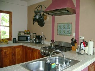 Tola house photo - Spacious Kitchen with Modern appliances