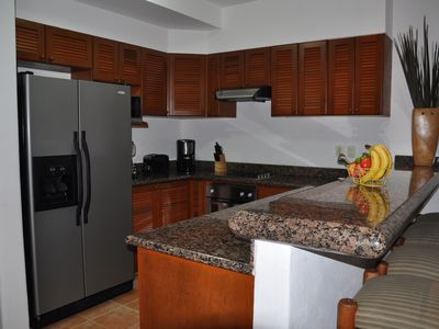 Modern kitchen, granite counters, mahogany cupboards, tile floor & SS appliances