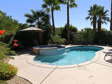 Palm Springs house rental - View of pool, hot tub, and pool deck from corner of property closest to house