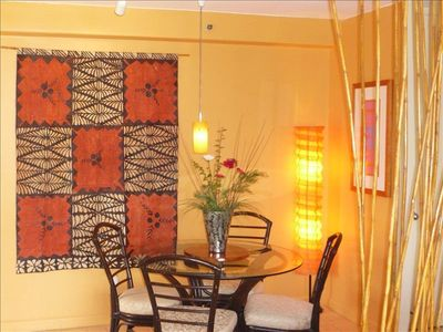Dining area with seating for 4. A beautiful Tongan tapa cloth adorns the wall.