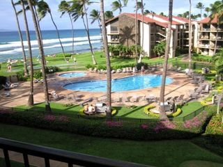 View of the pool, hottub, grounds from private lanai, perfect for morning coffee - Lahaina condo vacation rental photo