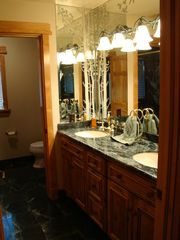Sundance cabin photo - 2nd Floor- Marble Bathroom. Double sinks. Private Europen shower w/ two heads.