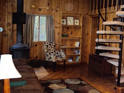 Mora cabin rental - Living room showing spiral stairs to loft.
