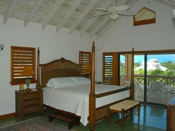 Upper floor master suite with kitchenette and private porches