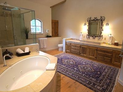 The master bathroom has a huge jetted tub & steam shower
