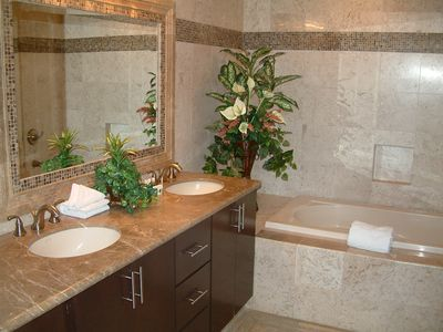 Luxury bathrooms with full travertine tile