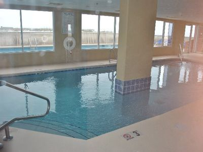 Indoor pool with view to outdoor pool