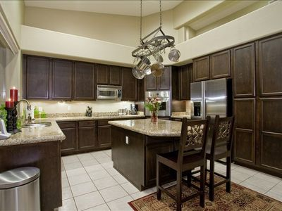 Eat-in kitchen features SS Viking appliances, granite, picture window to patio