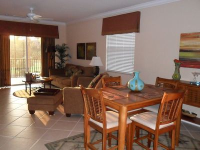 Living room/dining room with high-top bamboo dining table & buffet,