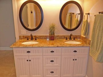 Bath 3 with has double vanities, tub/shower and a separate toilet room.