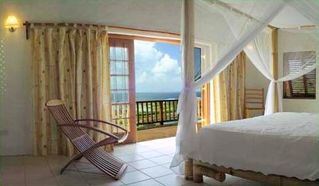Master Bedroom open to deck - Cap Estate villa vacation rental photo