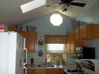 Cathedral ceiling with skylight in the kitchen - Buttermilk Bay cottage vacation rental photo