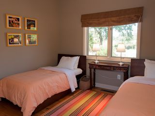 Sonoma house photo - Twin beds (one with a trundle) look out on the pool from the fourth bedroom