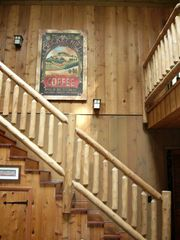 All Log Stairs to the loft and Master bedroom. - Union Pier house vacation rental photo