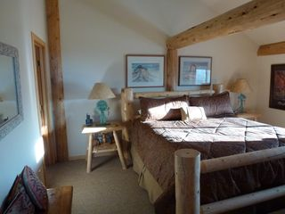 Master bedroom upostairs with King bed and private bathroom - Mesa Verde cabin vacation rental photo