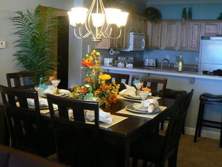 Tropic Winds condo photo - Dining room seats 6 and 4 stools at the counter