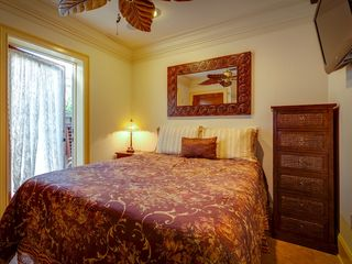 Key West house photo - The 2nd bedroom has a queen bed, overhead fan & flat screen TV.