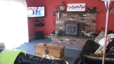 "Living room with soapstone furnace, 42"" LCD TV, and BluRay player."