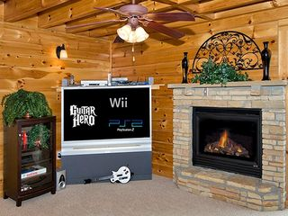Pigeon Forge cabin photo - relax in front of the fire or play video games