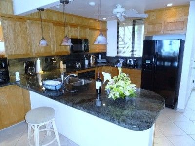 Deluxe kitchen with granite counter tops and new cabinets. Includes ice maker.