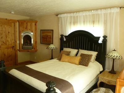 Master Bedroom: queen-sized bed, fireplace