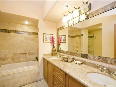 Enjoy the luxurious Travertine accented bathroom sinks, showers and baths.