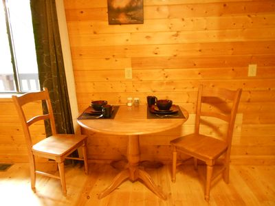 Dining area in open Kitchen/Living Room of Wears Valley rental cabin.