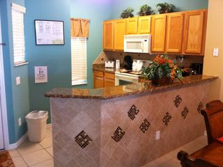 Upgraded kitchen with new tile splash back and new granite bench tops
