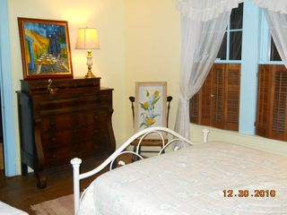 Ludington house photo - Double bed in suite room. To left of dresser is door to sunroom.