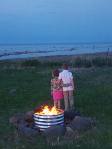 Cozy night time fires by the water.