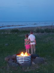 Harbor Beach cottage photo - Cozy night time fires by the water.