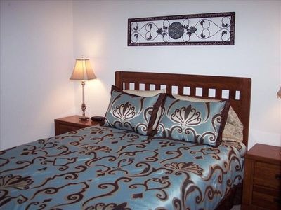 Downstairs Queen  Bed and flat-screen TV
