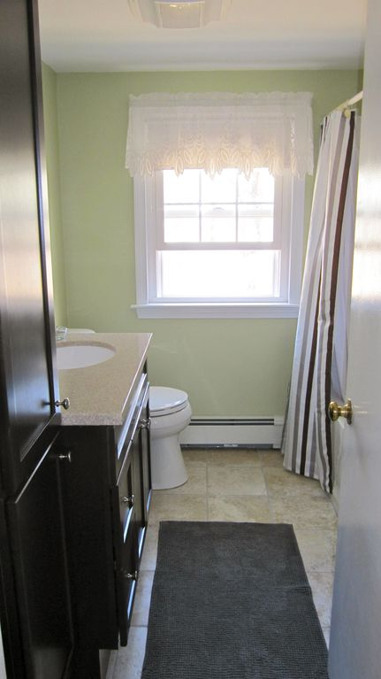 Upstairs bathroom newly remodeled with tub/ shower