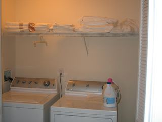 laundry center w/ white linens/towels available - Beach Haven townhome vacation rental photo