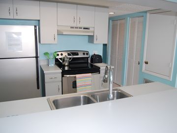 Full-kitchen with Stainless steel appliances.