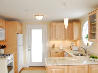 Portland condo photo - Kitchen-(Model) DW, gas stove, micro, fridge, granite, cookware, dishes, cutlery