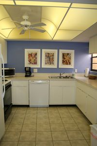 A sunny and fully equipped kitchen.