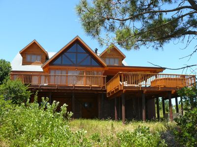 Luxury log home with lake and mountain views, close to world-class golf courses