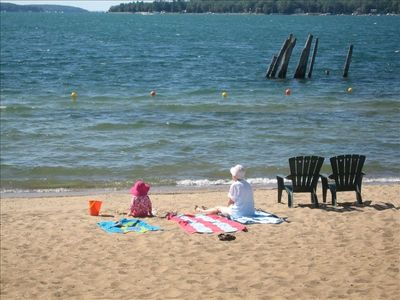 Boyne City condo rental - Lake Charlevoix, clean sandy beach ouside the front door