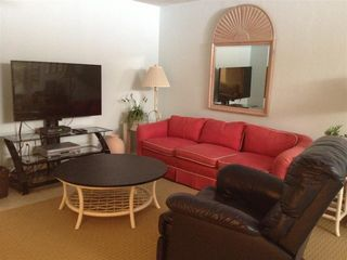 New Smyrna Beach townhome photo - Downstairs bonus room with new 50' LED TV and computer area. Couch/Chairs.