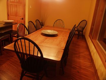 Large kitchen table with chairs for 10 and an additional 3 stools at the island