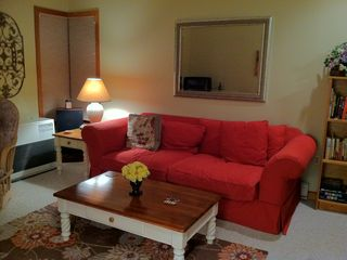 Living room with comfy sofa and loveseat offers TV with VCR, DVD and cable.